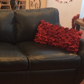 red pillows for the furniture - no detail left undone.